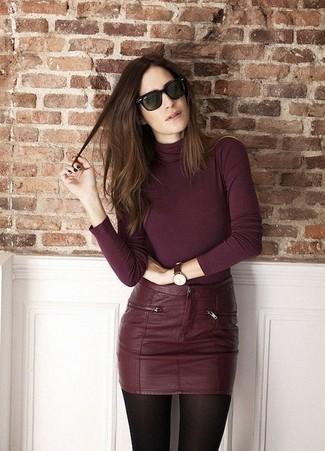 A burgundy turtleneck and a burgundy leather mini skirt feel perfectly suited for weekend activities of all kinds.