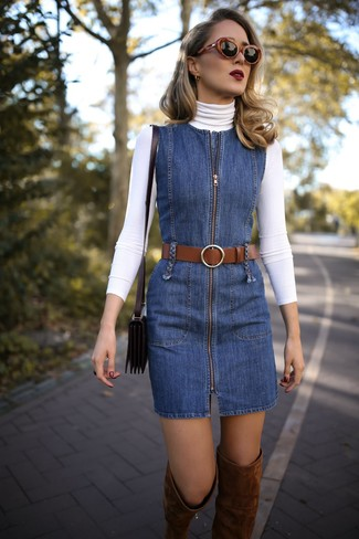 How to wear: white turtleneck, blue denim overall dress, brown suede over the knee boots, black leather crossbody bag