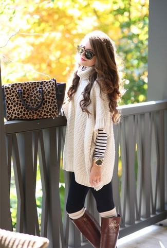 Step up your off-duty look in an oversized sweater and a white and navy striped rollneck. Brown leather knee high boots are a savvy choice to complete the look.