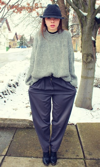 A charcoal knit oversized sweater and navy wide leg pants are appropriate for both smart casual events and day-to-day wear. This outfit is complemented perfectly with black leather lace-up ankle boots.