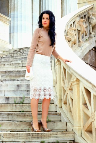 Show off your sophisticated side in a beige rollneck and a white lace pencil skirt. This outfit is complemented perfectly with brown snake leather pumps.