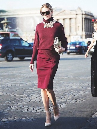 Dress in an oxblood turtleneck and a burgundy pencil skirt for a sleek elegant look. White leather pumps are a nice choice to complete the look.