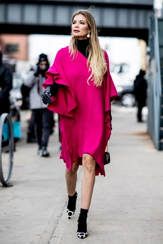 How to wear: black turtleneck, hot pink ruffle shift dress, white and black polka dot suede pumps, black leather handbag