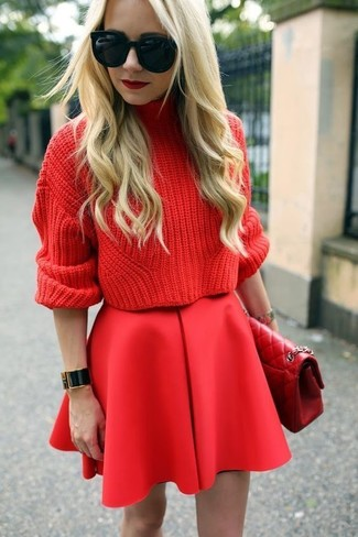 How to Wear a Red Quilted Leather Satchel Bag: Try pairing a red knit turtleneck with a red quilted leather satchel bag for a casual look with a modern twist.