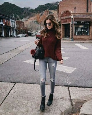 Effortlessly blurring the line between chic and casual, this combo of an oxblood knit wool turtleneck and grey destroyed slim jeans is likely to become one of your favorites. Black leather ankle boots will add elegance to an otherwise simple look. You can bet this ensemble is the answer to all of your transeasonal style woes.
