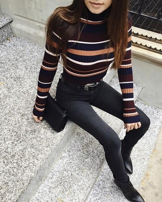 How to wear: multi colored horizontal striped turtleneck, black skinny jeans, black leather ankle boots, black leather crossbody bag