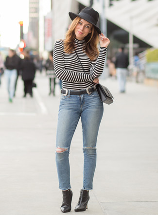 Women's Looks & Outfits: What To Wear In 2020: Extremely chic and comfortable, this combo of a black and white horizontal striped turtleneck and light blue ripped skinny jeans delivers variety. Our favorite of a myriad of ways to round off this outfit is black leather ankle boots.