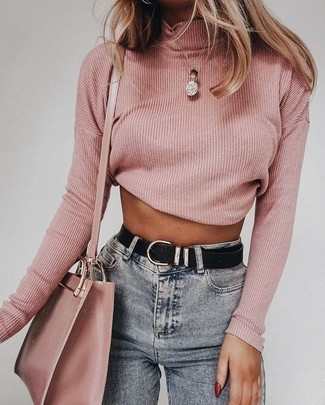 Get into glamour mode in a pink turtleneck and a Saint Laurent Small Mono Leather Camera Bag. An amazing example of transitional style, this getup is a staple when spring sets it.