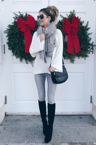 How to Wear Black Suede Knee High Boots: A white knit wool turtleneck and grey skinny jeans are stylish pieces, without which our closets would feel incomplete. If not sure about the footwear, add a pair of black suede knee high boots to the equation.