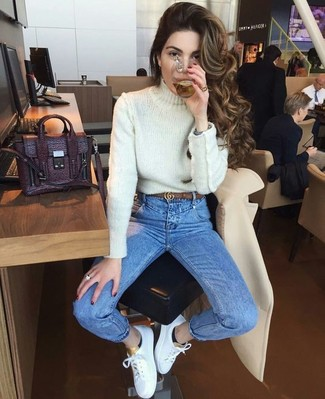 How to Wear a Brown Leather Belt For Women: For a look that brings functionality and style, reach for a white knit turtleneck and a brown leather belt. On the shoe front, this ensemble pairs brilliantly with white leather low top sneakers.