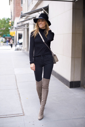 How to Wear a Grey Leather Crossbody Bag: A black turtleneck and a grey leather crossbody bag are certainly worth adding to your list of true casual staples. Bring an instant sultry vibe to your getup by sporting a pair of grey suede over the knee boots.