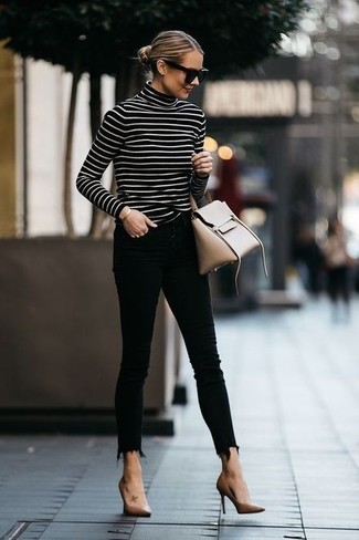 If you're scouting for a casual yet totally stylish ensemble, pair a black and white horizontal striped turtleneck with black skinny jeans. Both pieces are totally comfy and will look fabulous together. A pair of Kate Spade New York Licorice Pumps adds more polish to your overall look.  There's no nicer way to spice up a dull fall day than a chic ensemble like this one. (Ok, maybe there are a couple.)