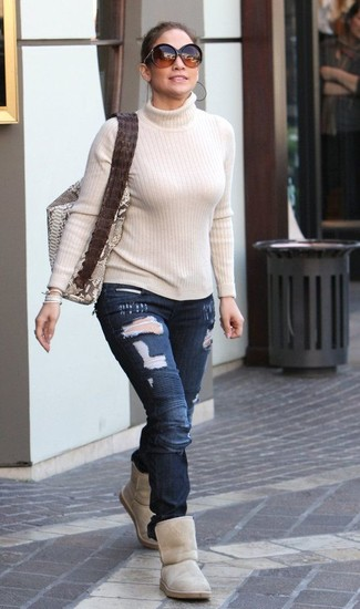 How to Wear a Beige Turtleneck In a Relaxed Way For Women: For comfort dressing with a twist, you can easily rock a beige turtleneck and navy ripped skinny jeans. Beige uggs are a fail-safe way to add an element of stylish nonchalance to this outfit.