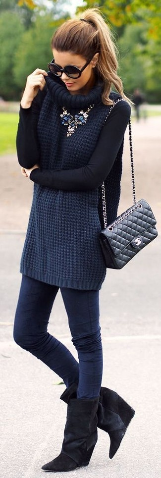 How to wear: navy knit turtleneck, navy skinny jeans, black suede wedge ankle boots, black quilted leather satchel bag