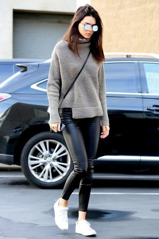 Kendall Jenner wearing Grey Knit Turtleneck, Black Leather Skinny Pants, White Low Top Sneakers, Black Leather Crossbody Bag