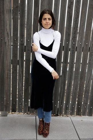 Consider wearing a white turtleneck and blue jeans for a comfortable outfit that's also put together nicely. Look at how well this outfit pairs with tan leopard calf hair ankle boots. This combination is a wonderful choice come warmer days.