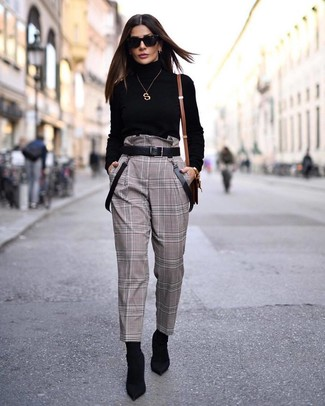 How to Wear Black Elastic Ankle Boots: Effortlessly blurring the line between cool and casual, this combination of a black turtleneck and brown check tapered pants can easily become your go-to. When not sure about what to wear on the shoe front, complement this look with a pair of black elastic ankle boots.