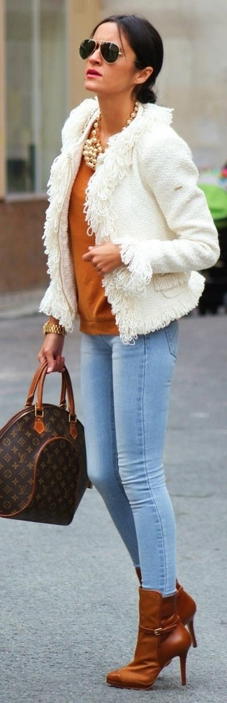 How to wear: white tweed jacket, tobacco crew-neck sweater, light blue skinny jeans, tobacco leather ankle boots