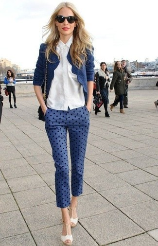 A dark blue tweed jacket with capri pants has become an essential combination for many style-conscious girls. Play down the casualness of your getup with cream leather heeled sandals. It goes without saying that this one makes for a great, spring-appropriate outfit.