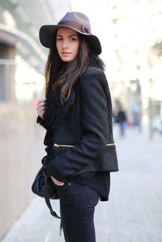 This combination of a black tweed jacket and a black fur scarf is proof that a simple look doesn't have to be boring. Rest assured, this getup will keep you toasty as well as looking seriously stylish in this summer-to-fall weather.
