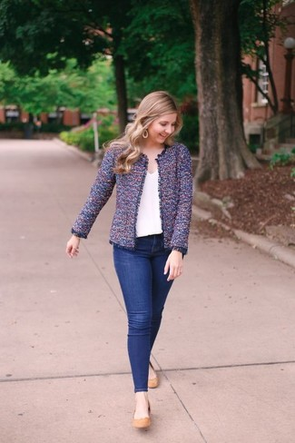 Nail glam in a violet tweed jacket and navy skinny jeans. Ballerina shoes will give your look an on-trend feel. An amazing example of transitional style, this getup is an essential come spring.