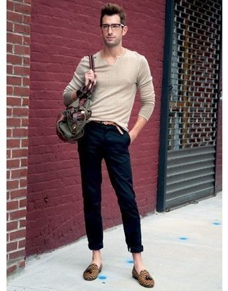 How to Wear an Olive Canvas Tote Bag For Men: You'll be surprised at how easy it is for any gent to get dressed like this. Just a beige v-neck sweater matched with an olive canvas tote bag. For extra fashion points, add a pair of tan leather tassel loafers to the mix.