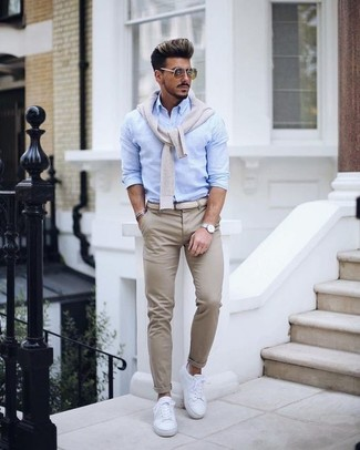 How to wear: beige v-neck sweater, light blue dress shirt, beige chinos, white leather low top sneakers