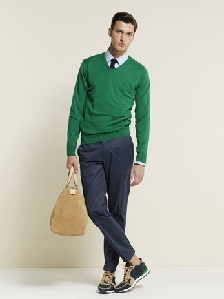 How to Wear Athletic Shoes For Men: A green v-neck sweater and navy chinos are among those super versatile menswear staples that can upgrade your wardrobe. Kick up your look by slipping into a pair of athletic shoes.