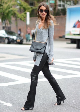 How to wear: grey v-neck sweater, black leather flare pants, black leather mules, black leather crossbody bag