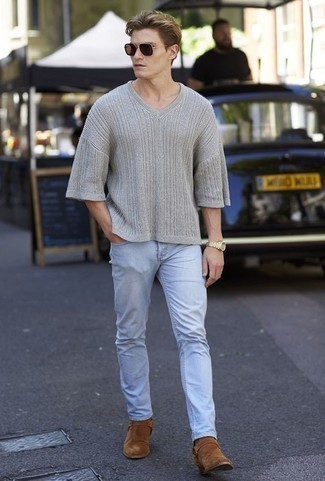 How to Wear a Grey V-neck Sweater For Men: This pairing of a grey v-neck sweater and light blue jeans is hard proof that a safe casual outfit can still look extra dapper. Introduce brown suede chelsea boots to the mix to jazz things up.