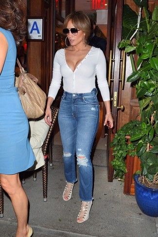 How to wear: white v-neck sweater, blue ripped jeans, beige canvas heeled sandals, black sunglasses