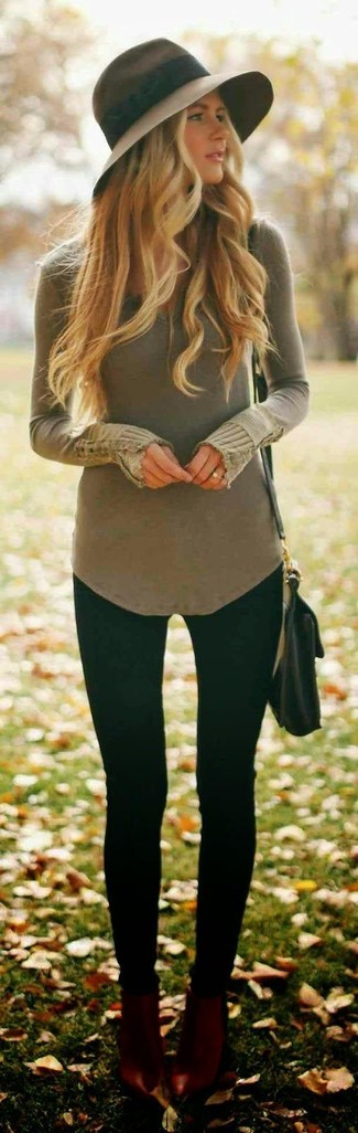 An olive v-neck sweater and black leggings is a wonderful combo to add to your casual lineup. A pair of oxblood leather ankle boots adds some real flair to this ensemble. So as you can see, this combo is a really great idea, especially for weird fall weather, when the mercury is dropping.