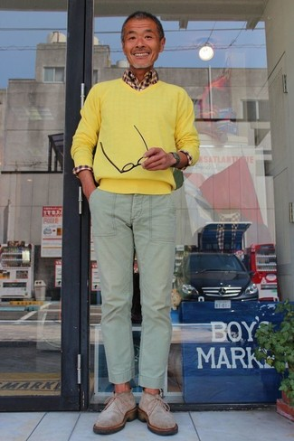 How to wear: yellow v-neck sweater, brown gingham long sleeve shirt, mint chinos, grey suede desert boots