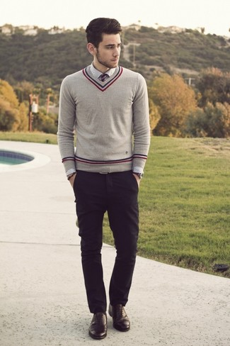 A grey v-neck pullover and black chinos are great staples that will integrate perfectly within your current looks. A cool pair of black leather oxford shoes is an easy way to upgrade your look.