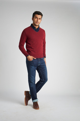 Men's Looks & Outfits: What To Wear In 2020: Reach for a burgundy v-neck sweater and navy jeans to achieve an extra sharp and modern-looking laid-back ensemble. All you need is a cool pair of brown leather boat shoes.