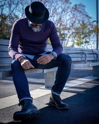How To Wear Blue Jeans With Black Leather Boots For Men: For an ensemble that provides function and dapperness, team a dark purple v-neck sweater with blue jeans. If you want to effortlessly class up this getup with footwear, complement this look with black leather boots.