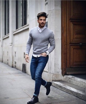 How to Wear Black Leather Desert Boots: This combination of a grey v-neck sweater and navy jeans is a safe and very fashionable bet. Add black leather desert boots to your look for extra fashion points.