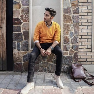 Black Jeans Spring Outfits For Men: A mustard v-neck sweater and black jeans are wonderful menswear staples that will integrate well within your off-duty styling routine. If you feel like dialing it up a bit, grab a pair of beige suede chelsea boots. As the weather begins to warm up again, it's time to  get rid of those heavy winter layers and choose a look that's lighter, like this one here.