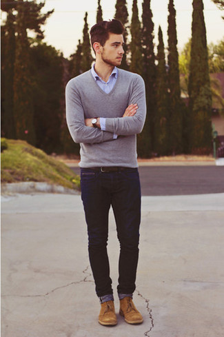 For an everyday outfit that is full of character and personality marry a grey v-neck pullover with navy jeans. Complement this look with tan suede desert boots.