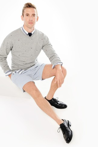 How to wear: grey v-neck sweater, white and blue horizontal striped long sleeve shirt, light blue vertical striped seersucker shorts, black leather brogues