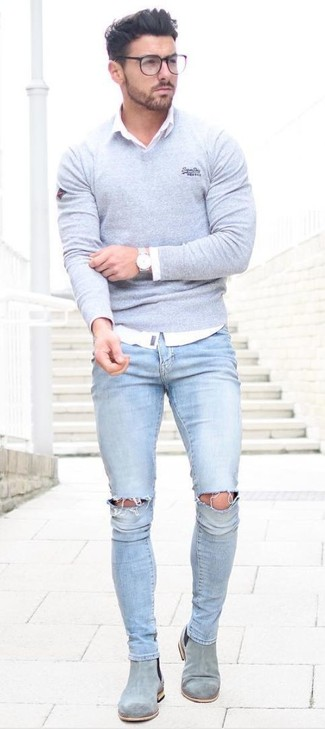 Grey V-neck Sweater Outfits For Men: Such essentials as a grey v-neck sweater and light blue ripped skinny jeans are an easy way to introduce some cool into your casual arsenal. Bring an elegant twist to this getup by rocking a pair of grey suede chelsea boots.