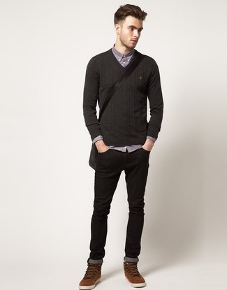 How to wear: charcoal v-neck sweater, grey chambray long sleeve shirt, black skinny jeans, brown suede casual boots