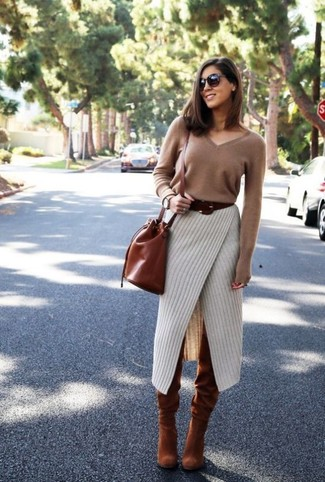How to Wear a Tobacco Leather Bucket Bag: Extremely chic, this pairing of a brown v-neck sweater and a tobacco leather bucket bag provides with variety. Want to dress it up when it comes to shoes? Complete your getup with a pair of tobacco suede over the knee boots.