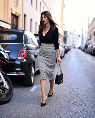 How to wear: black v-neck sweater, white and black houndstooth pencil skirt, black satin pumps, black leather satchel bag