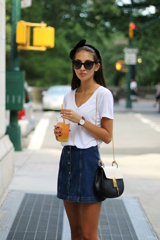 How to wear: white v-neck t-shirt, navy denim button skirt, black and white leather crossbody bag, black sunglasses