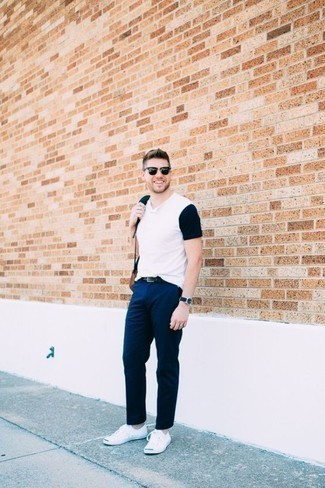 How to Wear a V-neck T-shirt For Men: Prove that no-one does casual quite like you do by wearing a v-neck t-shirt and navy chinos. Let your outfit coordination sensibilities truly shine by rounding off this getup with white canvas low top sneakers.