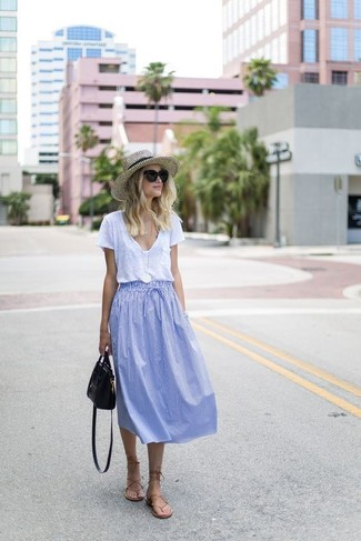 Consider wearing a v-neck t-shirt and a light blue pleated midi skirt to show off your styling smarts. Want to go easy on the shoe front? Opt for a pair of tan leather gladiator sandals for the day. Seeing as it's roasting hot outside, this getup seems perfect and entirely summer-friendly.