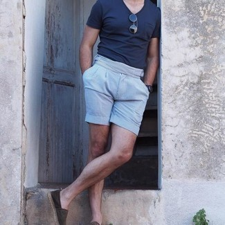 Espadrilles Outfits For Men: Pair a navy v-neck t-shirt with light blue vertical striped shorts if you're in search of an outfit idea that conveys casual dapperness. Make your ensemble slightly sleeker by finishing off with a pair of espadrilles.