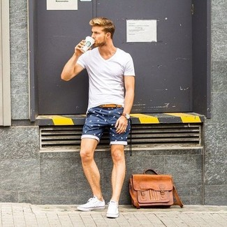 How to wear: white v-neck t-shirt, navy print shorts, white canvas low top sneakers, tan leather messenger bag