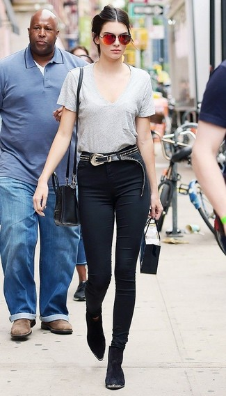 Marry a grey v-neck t-shirt with a Fossil Studded Leather Belt for a relaxed take on day-to-day wear. Sporting a pair of black suede ankle boots is an easy way to add extra flair to your getup. Seeing as temps are dropping, this outfit appears a nice idea for the time in between seasons.
